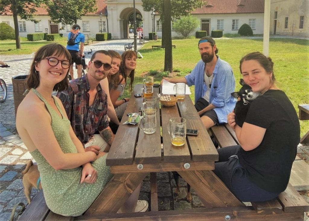 A group of TEFL trainees sitting at a pick-nick bench drinking beer