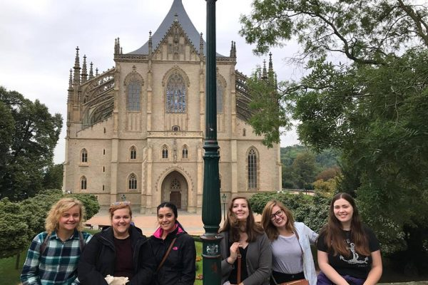 Group of TEFL trainees and trainers in Kutna Hora standing in front of cathederal