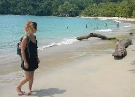 TEFL graduate on a tropical beach with golden sands
