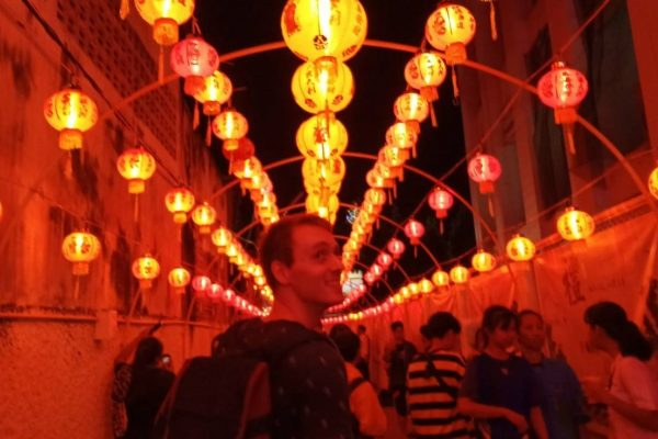 TEFL Graduate standing in front of lanterns in Thailand