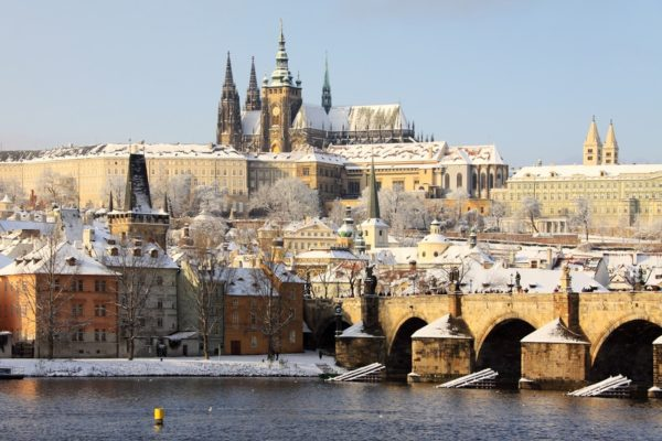 Prague castle and Charles Bridge covered in snow in winter